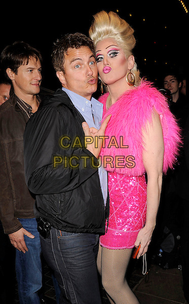 """JOHN BARROWMAN & DRAG ARTIST .""""Priscilla Queen of the Desert"""" Opening Gala Night at the Palace Theatre, London, England, March 24th 2009. .half length black jacket pink dress funny fluffy sparkly plastic pouting face lips drag queen .CAP/CAN.©Can Nguyen/Capital Pictures"""
