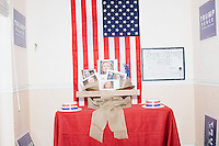 """A display titled """"The Real Deplorables"""" with images of Hillary Clinton, Debbie Wasserman Schultz, and other Democratic party members is visible in the Donald Trump campaign office in Hialeah, Miami, Florida.The title is a reference to Hillary's comment during a campaign speech that half of Trump's supporters are """"deplorables."""""""
