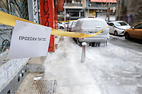"Pictured: An ""Attention Ice"" sign in central Salonika, Greece. Monday 09 January 2017<br /> Re: Severe cold weather affects Salonica in northern Greece"