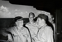 U.S. Navy Vice Admiral John Sidney McCain aboard his flagship the USS Shangri-La with Asst. Secretary of the Navy for Air John L. Sullivan and Captain John S. Thach.  - July 1945