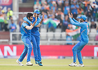 KL Rahul (India) congratulates Jasprit Bumrah (India), as Ravindra Jadeja (India) races in  on the wicket of Guptill during India vs New Zealand, ICC World Cup Semi-Final Cricket at Old Trafford on 9th July 2019