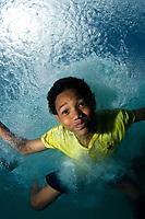 Bonaire boy underwater, Bonaire, Netherland Antilles, Caribbean Sea, Atlantic Ocean