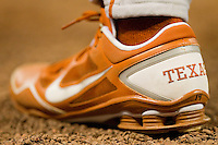 A close-up of the Nike cleat of Texas Longhorns first baseman Kevin Lusson #14 during the game against the Tennessee Volunteers at Minute Maid Park on March 3, 2012 in Houston, Texas.  The Volunteers defeated the Longhorns 5-4.  (Brian Westerholt/Four Seam Images)