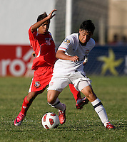 Esteban Rodriguez (8) of the United States gets past Darwin Pinzon (10) of Panama during the group stage of the CONCACAF Men's Under 17 Championship at Jarrett Park in Montego Bay, Jamaica. The USA defeated Panama, 1-0.