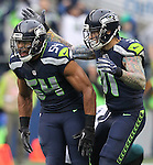 Seattle Seahawks outside linebacker Cassius Marsh (91) celebrates with middle linebacker Bobby Wagner (54) after  sacking Philadelphia Eagles Quarterback Carson Wentz (11) at CenturyLink Field in Seattle, Washington on November 20, 2016.  Seahawks beat the Eagles 26-15.  ©2016. Jim Bryant Photo. All Rights Reserved.