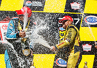 Jul 30, 2017; Sonoma, CA, USA; NHRA funny car driver J.R. Todd (right) celebrates with pro stock driver Tanner Gray after winning the Sonoma Nationals at Sonoma Raceway. Mandatory Credit: Mark J. Rebilas-USA TODAY Sports