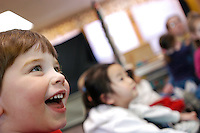 Jacob Helmuth (L), Sophia Choi (center) and other children .ages 2 to 3 in the Linden Drive Preschool Lab affiliated with the School of Human Ecology sing a song together during &quot;Chipmunk&quot; group time.<br /> <br /> Client: University of Wisconsin-Madison<br /> &copy; UW-Madison University Communications 608-262-0067<br /> Photo by: Michael Forster Rothbart<br /> Date: 1/03    File#:   D100 digital camera frame 0581.