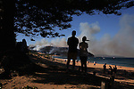 Eighty firefighters and three helicopters worked to contain a fire that swept across the Barrenjoey Headland that threatened the 1800s lighthouse at Palm Beach on Saturday afternoon. Sydney, Australia. Saturday 28th September 2013.(Photo:Steve Christo).