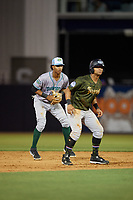 Daytona Tortugas shortstop Jose Garcia (13) in position behind base runner Tyler Hill (9) during a Florida State League game against the Tampa Tarpons on May 18, 2019 at George M. Steinbrenner Field in Tampa, Florida.  Daytona defeated Tampa 7-6.  (Mike Janes/Four Seam Images)