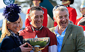 14h April 2018, Aintree Racecourse, Liverpool, England; The 2018 Grand National horse racing festival sponsored by Randox Health, day 3; Owner Michael O'Leary and his wife Anita with the winning jockey Davy Russell celebrate winning the Grand National with their horse Tiger Roll