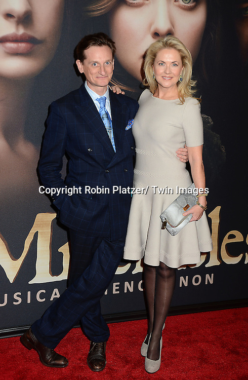 "Hamish Bowles and Cornelia Guest attends the American Premiere of ""Les Miserables"" on December 10, 2012 at the Ziegfeld Theatre in New York City. The movie stars Hugh Jackman, Anne Hathaway, Amanda Seyfried, Eddie Redmayne, Russell Crowe, Samantha Barks, Isabelle Allen and Sacha Baron Cohen."