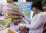 March 3, 2015, Chiba, Japan - A picture released on March 4, 2015 shows a visitor trying samples of roasted nuts at the Spain booth during the 40th annual International Food and Beverage Exhibition (FOODEX JAPAN 2015). Some 2,977 exhibitors from 79 nations participate in what is known to be the largest food and beverage exhibition in Asia. 75,000 buyers which include wholesalers, food service companies, and distributors are expected to attend FOODEX which runs from March 3-6. (Photo by AFLO)