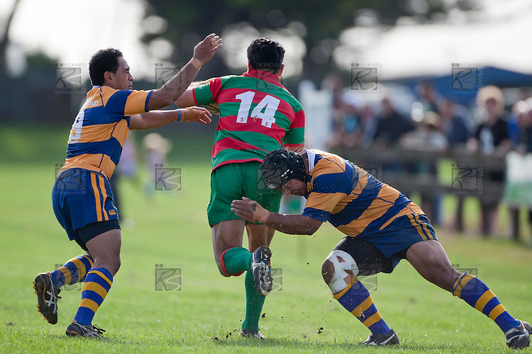 Kaino Kaino and Ilaisa Maasi move in to stop the run of  Opeta Lafotas. Counties Manukau Premier Club Rugby game between Waiuku and Patumahoe, played at Waiuku on Saturday April 23rd 2011. Patumahoe won 21 - 20 after leading 6 - 0 at halftime.