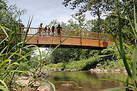 A bridge leads across Meadow creek along the Rivanna Trail in Charlottesville, Va. Photo/Andrew Shurtleff