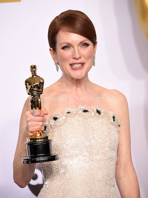 WWW.ACEPIXS.COM<br /> <br /> February 22 2015, LA<br /> <br /> Julianne Moore in the press room at the 87th Annual Academy Awards at Loews Hollywood Hotel on February 22, 2015 in Hollywood, California. <br /> <br /> By Line: Z15/ACE Pictures<br /> <br /> <br /> ACE Pictures, Inc.<br /> tel: 646 769 0430<br /> Email: info@acepixs.com<br /> www.acepixs.com