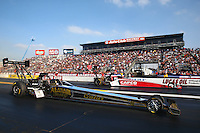 Feb 9, 2014; Pomona, CA, USA; NHRA top fuel dragster driver Khalid Albalooshi (near) defeats Steve Torrence during the Winternationals at Auto Club Raceway at Pomona. Mandatory Credit: Mark J. Rebilas-