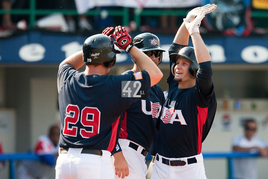 27 September 2009: Lucas May of Team USA celebrates with teammates after hitting a three run home run during the 2009 Baseball World Cup gold medal game won 10-5 by Team USA over Cuba, in Nettuno, Italy.