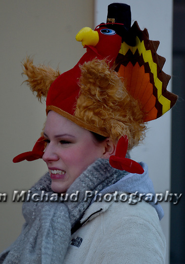 Frozen turkey -  a spectator is bundled up but clearly cold as she wears a turkey hat,  during the 81st running of the Manchester Road Race, Thursday, November 23, 2017, in  Manchester. (Jim Michaud / Journal Inquirer)