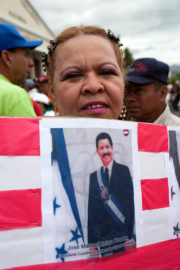 3 July 2009 - Tegucigalpa, Honduras  Supporter of ousted Honduran President Manuel Zelaya during a march in Tegucigalpa, capital of Honduras. Zelaya has been forced into exile after being arrested by a group of soldiers in an apparent military coup. Photo credit: Benedicte Desrus