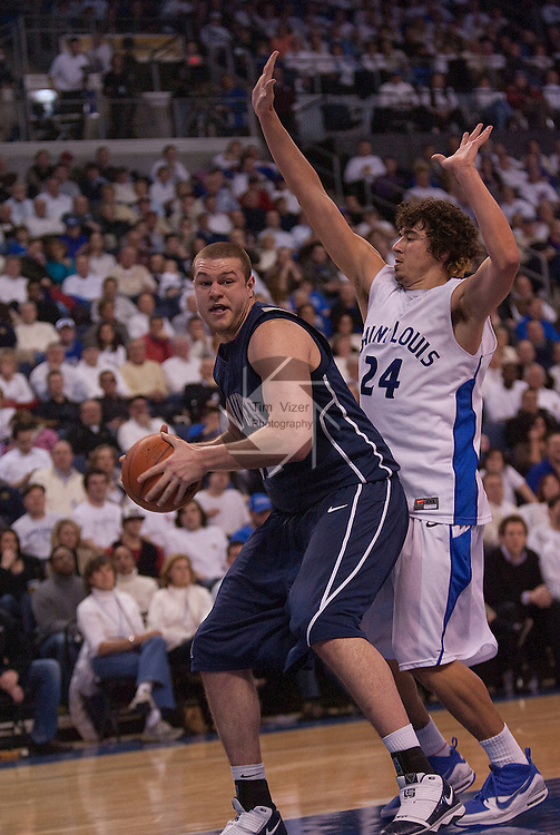 February 24,  2010                Xavier center Kenny Frease (32) is guarded by Saint Louis forward Cody Ellis (24) in the second half.   The St. Louis University Billikens hosted the Xavier University Musketeers on Wednesday February 24, 2010 at the Chaifetz Arena, located on the campus of St. Louis University near downtown St. Louis.  Xavier ended Saint Louis' six-game winning streak, with a final score of 73-71.
