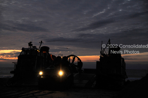 An amphibious assault vehicle is offloaded from a landing craft, air cushion (LCAC) Monday, February 6, 2012 during a Bold Alligator 2012 amphibious landing exercise at Camp Lejeune, North Carolina. Bold Alligator 2012, the largest naval amphibious exercise in the past 10 years, represents the Navy and Marine Corps' revitalization of the full range of amphibious operations. The exercise focuses on today's fight with today's forces, while showcasing the advantages of seabasing. This exercise will take place January 30 through February 12, 2012 afloat and ashore in and around Virginia and North Carolina.    .Mandatory Credit: Gregory N. Juday / U.S. Navy via CNP