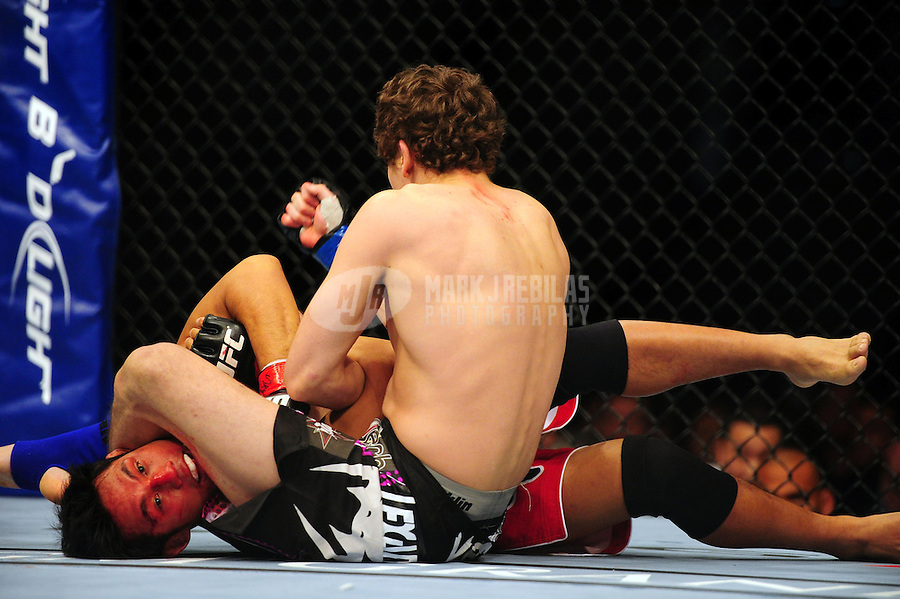 Dec 30, 2011; Las Vegas, NV, USA; UFC fighter Nam Phan (bottom) fights against Jimy Hettes during a featherweight bout at UFC 141 at the MGM Grand Garden event center. Mandatory Credit: Mark J. Rebilas-