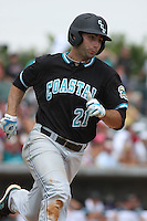 The Coastal Carolina University Chanticleers First Baseman Rich Witten #21 running to first base during the 2nd and deciding game of the NCAA Super Regional vs. the University of South Carolina Gamecocks on June 13, 2010 at BB&T Coastal Field in Myrtle Beach, SC.  The Gamecocks defeated Coastal Carolina 10-9 to advance to the 2010 NCAA College World Series in Omaha, Nebraska. Photo By Robert Gurganus/Four Seam Images