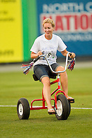 A fan races a giant tricycle between innings of the Appalachian League game between the Pulaski Mariners and the Burlington Royals at Burlington Athletic Park on June20 2013 in Burlington, North Carolina.  The Royals defeated the Mariners 2-1 in 13 innings.  (Brian Westerholt/Four Seam Images)