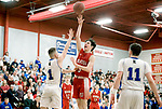 WOLCOTT, CT-031418JS06- Wamogo's  Reid Turtoro (5) puts up a shot over East Hampton's Nic DiStefano (1) during their Division V semifinal game Wednesday at Wolcott High School. <br /> Jim Shannon Republican-American