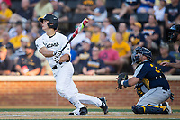 Stuart Fairchild (4) of the Wake Forest Demon Deacons follows through on his swing against the West Virginia Mountaineers in Game Four of the Winston-Salem Regional in the 2017 College World Series at David F. Couch Ballpark on June 3, 2017 in Winston-Salem, North Carolina.  The Demon Deacons walked-off the Mountaineers 4-3.  (Brian Westerholt/Four Seam Images)