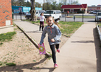 NWA Democrat-Gazette/CHARLIE KAIJO Myah Barnes 9 (center) and Abigail Mulcare, 9, search for Easter eggs during an Easter egg hunt, Friday, April 12, 2019 at the Boys and Girls Club in Rogers. <br /> <br /> The Mitchell Williams Law Firm gave the Boys and Girls club of Rogers a $15,000 grant and held an egg hunt for the kids of the club. They offer grants each year through a program called Take Time To Give. The purpose is to encourage the law staff to do charitable work said Kyle Heffley, an attorney from the firm. <br /> <br /> The Boys and Girls club has five facilities in the county serving 150-200 kids at each site. The clubs experience a lot of wear-and-tear. Contributions from community organizations help the staff to focus on serving the kids.