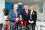Minister Jimmy Deenihan cutting the ribbon at J.F. Flynn Construction with John and Michelle Flynn