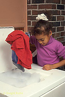 BH22-076x  Bubbles - girl putting clothes in clothes washer