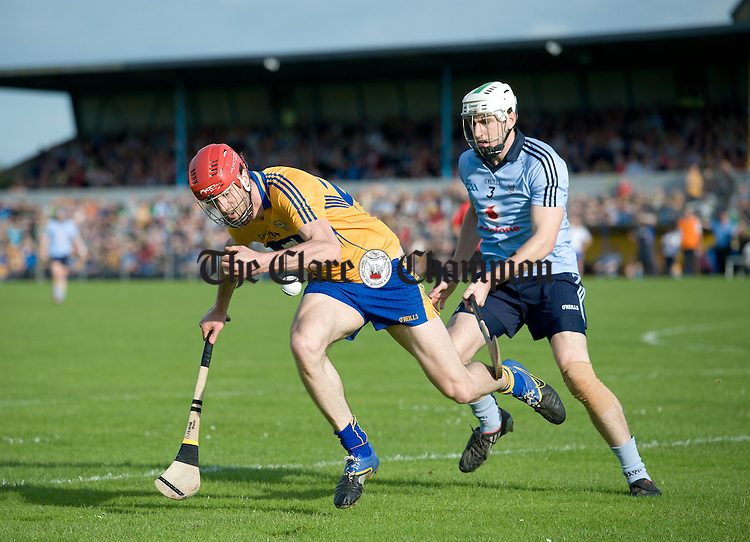 Darach Honan of Clare in action against Peter Kelly of Dublin during their All-Ireland senior championship phase 2 qualifier at Cusack Park. Photograph  by John Kelly.