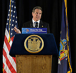 Seaford, New York, USA. 3rd June 2015. New York State Governor ANDREW CUOMO speaks at an event in support of extending the NY Property Tax Cap. At the bi-partisan Press Conference at Knights of Columbus Hall, over a hundred area residents and officials urged an extension of the property tax cap before the state legislative session ends on June 17. The NY Property Tax Cap is set to expire June 2016, but is legally linked to NYC rent-control regulations set to expire this month. In June 2011 in Nassau County, the governor signed the first property tax cap law. Podium has The Great Seal of New York and sign with message: Keep the Cap, Property Tax Relief for Families and Businesses.