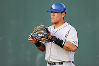 Catcher Wilfredo Rodriguez (3) of the Asheville Tourists warms up before a game against the Greenville Drive on Monday, April 21, 2014, at Fluor Field at the West End in Greenville, South Carolina. Greenville won, 8-3. (Tom Priddy/Four Seam Images)