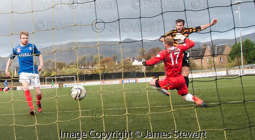 Alloa's Liam Buchanan scores their first goal.