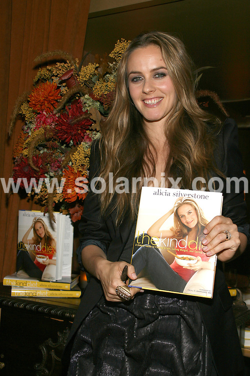 "**ALL ROUND PICTURES FROM SOLARPIX.COM**.**SYNDICATION RIGHTS FOR UK, AUSTRALIA, DENMARK, PORTUGAL, S. AFRICA, SPAIN & DUBAI (U.A.E) ONLY**.Alicia Silverstone's ""The Kind Diet: A Simple Guide to Feeling Great, Losing Weight, and Saving the Planet"" Book Launch Party at Candle 79, New York City, NY, USA. 8 October 2009..This pic: Alicia Silverstone..JOB REF: 10088 PHZ (Gaboury)   DATE: 08_10_2009.**MUST CREDIT SOLARPIX.COM OR DOUBLE FEE WILL BE CHARGED**.**MUST NOTIFY SOLARPIX OF ONLINE USAGE**.**CALL US ON: +34 952 811 768 or LOW RATE FROM UK 0844 617 7637**"