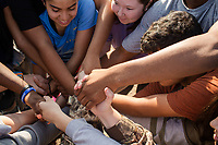 Fresnman Gisell Cervantes, (CQ) 14, senior Makenzie Pittman, (CQ) 17, and others form a human knot during Peer Group Connection field day where freshmen students meet their senior mentors at Greene Central Central High School in Snow Hill, NC Friday, September 22, 2017. (Justin Cook for Education Week)