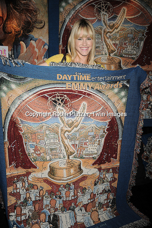 Julie Marie Berman holding a TreasureKnit blanket of The 35th Annual Daytime Emmy Awards Commemorative poster by Charles Fazzino.atThe Official Talent Gift Lounge at The 35th Annual Daytime Emmy Awards backstage at The Kodak Theatre on June 19, 2008 in Hollywood, California. ..Robin Platzer, Twin Images