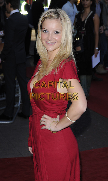 "HELEN SKELTON.""Legend Of The Guardians: The Owls of Ga'Hoole"" UK film premiere, Odeon West End, Leicester Square, London, England..October 10th 2010 .half length red dress wrap cleavage hand on hip smiling side.CAP/CAN.©Can Nguyen/Capital Pictures."