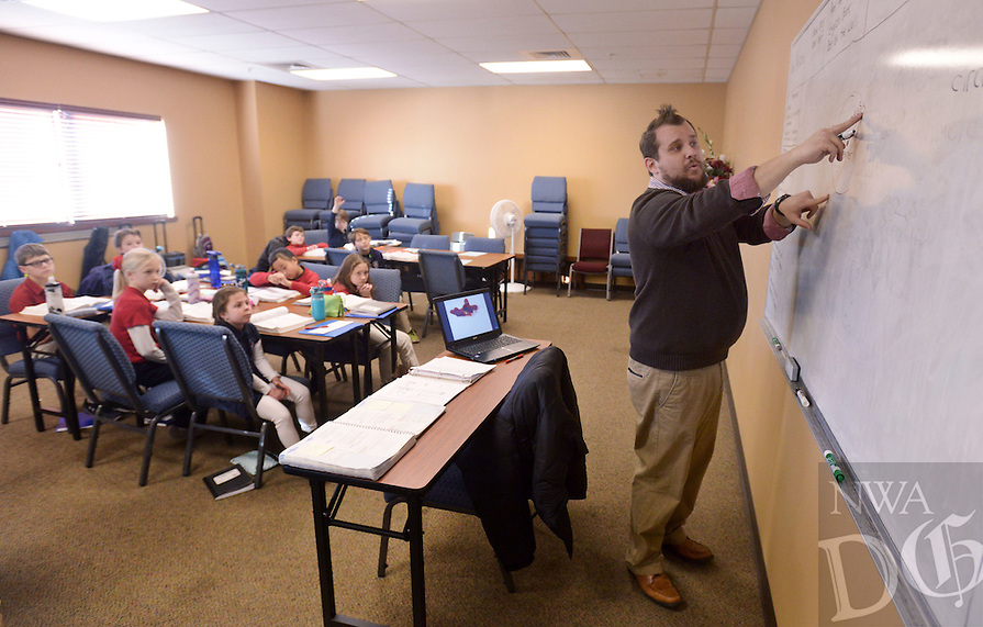 NWA Democrat-Gazette/BEN GOFF @NWABENGOFF<br /> Zach Spillman gives a geometry lesson in his 4th grade class on Monday Dec. 19, 2016 at Providence Academy's grammar school campus at Immanuel Baptist Church in Rogers.