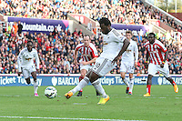 Sunday, 19 October 2014<br /> Pictured: Wilfried Bony of Swansea City scores his sides first goal from the penalty spot. 0-1<br /> Re: Barclay's Premier League, Stoke City FC v Swansea City FC v at Britannia Stadium, Stoke, Staffordshire,UK.