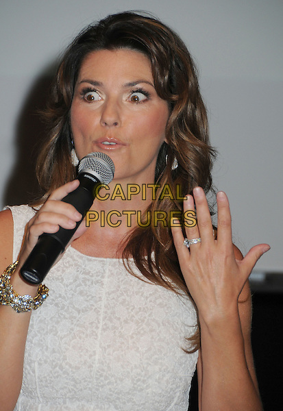 Shania Twain .Holds a  Press Conference announcing Superstar Residency at the Colosseum, Caesar's Palace, Nashville, Tennessee, USA, 8th June 2011..half length hand ring funny sleeveless white microphone speaking .CAP/ADM/LF.©Laura Farr/AdMedia/Capital Pictures.