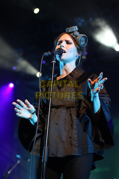 The Cardigans - Nina Persson.The Cardigans concert in Stadium Live, Moscow, Russia..July 11th, 2012.on stage gig performance performing music half length arms hands black top hairband hat singing .CAP/PER/AS.©AS/PersonaStars/Capital Pictures.