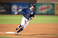 Northwest Arkansas Naturals infielder Travis Jones (27) rounds third during a Texas League game between the Northwest Arkansas Naturals and the Arkansas Travelers on May 30, 2019 at Arvest Ballpark in Springdale, Arkansas. (Jason Ivester/Four Seam Images)