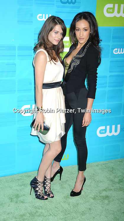 "Lyndsy Fonseca and Maggie Q of "" Nikita""  posing for photographers at the CW Network 2010 Upfront on May 20, 2010 at Madison Square Garden in New York City."