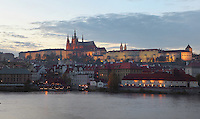 Evening view of the Lesser Quarter or Mala Strana, with Prague Castle, 10th - 14th centuries, the largest ancient castle in the world, and St Vitus cathedral, a Gothic Roman catholic cathedral founded 1344, seen from across the Vltava river, Prague, Czech Republic. The historic centre of Prague was declared a UNESCO World Heritage Site in 1992. Picture by Manuel Cohen