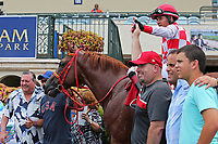 HALLANDALE BEACH, FL - JUNE 30:   #1 War Giant (KY) with jockey Emisael Jaramillo in the winners' circle after winning the Carry Back Stakes on Summit Of Speed Day at Gulfstream Park on June 30, 2018 in Hallandale Beach, Florida. (Photo by Liz Lamont/Eclipse Sportswire/Getty Images)