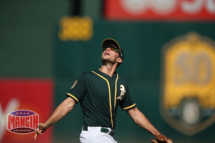 OAKLAND, CA - SEPTEMBER 20:  Matt Olson #28 of the Oakland Athletics chases a pop up against the Los Angeles Angels of Anaheim during the game at the Oakland Coliseum on Thursday, September 20, 2018 in Oakland, California. (Photo by Brad Mangin)